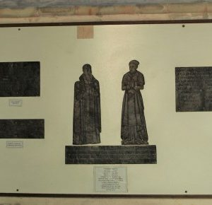 Memorial brasses on north wall