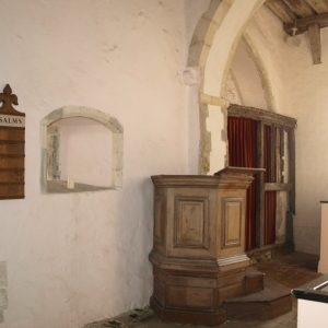 Squint to right of chancel arch
