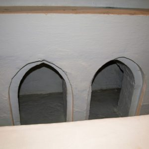 Reliquary niches in chancel east wall