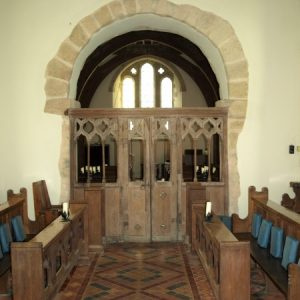 The chancel arch and screen
