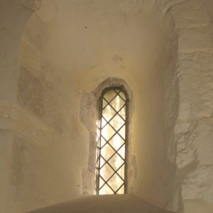Small Norman window in the nave