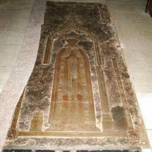 Brass tomb cover in chancel floor