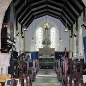 The chancel roof and east window