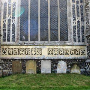 Lombardic lettering under east window