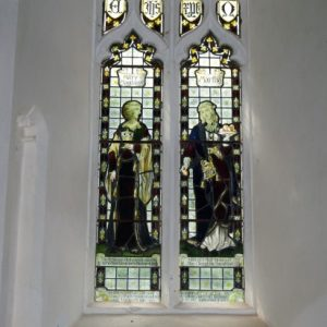 2-light window with stained glass depicting Mary Magdalene and Martha